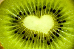 Kiwi Love. Another reason to love fruit: a kiwi slice with a heart-shaped middle Royalty Free Stock Photo