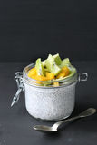Kiwi ,mango and chia seeds pudding in jar Stock Photo