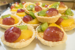 Kiwi, mango, grape delicious dessert fruit tart pastry Stock Photo