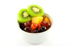 Kiwi, Melon and Grapes. Pot of fruit including kiwi, melon and grapes with clipping path on a white background Royalty Free Stock Photos