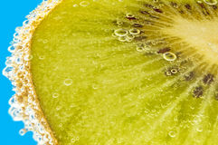 Kiwi in mineral water Royalty Free Stock Photo