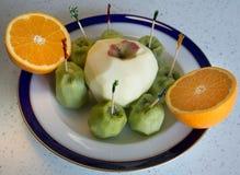 Kiwi, naranja y manzana Imagenes de archivo