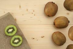 Kiwi on natural wood. Sliced kiwi on natural vood Stock Images