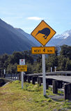 Kiwi next 4 km sign at Arthurs Pass, New Zealand. Stock Photos