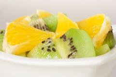 Kiwi och apelsin Arkivfoton