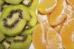 Kiwi och apelsin Royaltyfria Foton