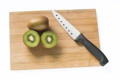 Kiwi och kniv Arkivfoto