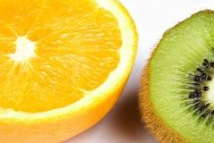 Kiwi and orange. Isolated slice of kiwi and orange on white background Stock Image