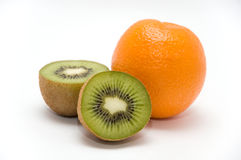 Kiwi and orange. Two halves of kiwi and one orange isolated on white background Royalty Free Stock Photography