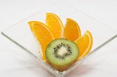 Kiwi and orange Stock Images