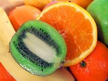 Kiwi and orange. Slices of kiwi and orange close up Stock Images