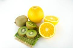 Kiwi and orange fruit isolated on white background Stock Photos