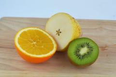 Kiwi, orange and pear cut royalty free stock photos