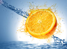 Kiwi and orange wet Royalty Free Stock Images