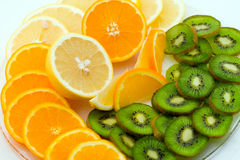 Kiwi and oranges Stock Image