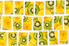 Kiwi oranges mix colorful sliced fruits  background collage Stock Images