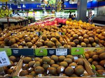 Kiwi and other fresh fruits on display at a supermarket Stock Photography