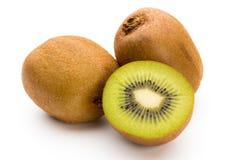 Kiwi owoc i pokrajać na białym tle Obraz Royalty Free