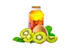 Kiwi owoc i witaminy butelka odizolowywająca na białym tle Obraz Royalty Free
