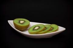 Kiwi owoc na talerzu Fotografia Royalty Free