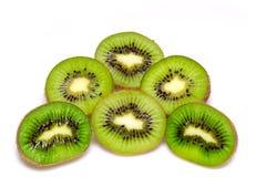 Kiwi owoc pokrajać segmenty odizolowywający na białej tło wycinance Fotografia Stock