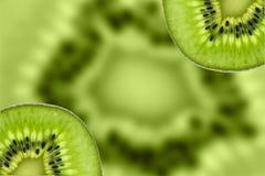 Kiwi owoc, Zamyka w górę pokrojonego kiwi abstrakcjonistycznego tła, Makro- widok Obrazy Royalty Free