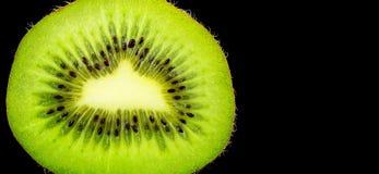 Kiwi på svart bakgrund royaltyfria foton