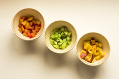 Kiwi, peach and plum in white bowls. Ideal for wallpapers. Could be useful in presentations, web and printing design Royalty Free Stock Photos