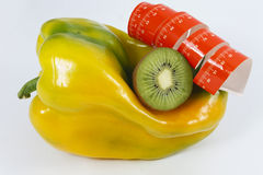 Kiwi pepper and tape measure Stock Images