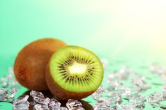 Kiwi and pieces of ice Stock Photos