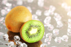 Kiwi and pieces of ice Stock Images