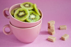 Kiwi in pink cups Stock Images