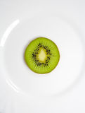 Kiwi on a plate Stock Photo