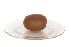 Kiwi. On a plate  on a white background Royalty Free Stock Image