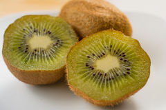 Kiwi with on plate Royalty Free Stock Photos