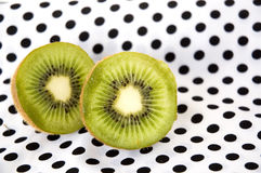 Kiwi on polka dots Stock Image