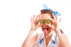 Kiwi pour les yeux et la langue traînant Image stock