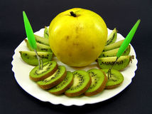 Kiwi and quince. On plate Royalty Free Stock Photo