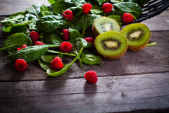 Kiwi, raspberries and baby spinach. Royalty Free Stock Photo
