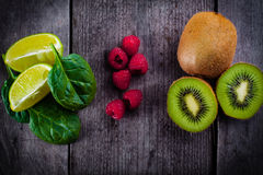 Kiwi, raspberries, lime and baby spinach. Stock Photo