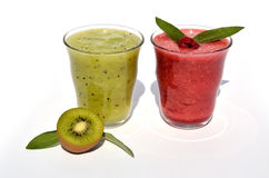 Kiwi and raspberry juice. Glasses of kiwi and raspberry juice with kiwi fruit and fresh leaves Stock Photos