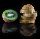 kiwi with reflection on black background Royalty Free Stock Image