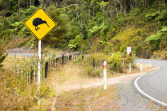 Kiwi road sign in New Zealand. A Kiwi bird road warning sign by the side of a road in New Zealand royalty free stock images