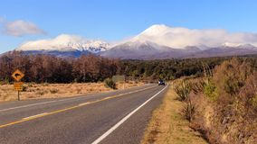 Kiwi road sign and volcano Ngauruhoe at Tongariro National Park stock images