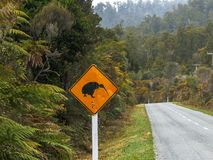 Kiwi road sign on the west coast of nz. Kiwi road sign on the west coast of new zealand stock photography