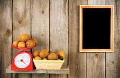 Kiwi on scales and in a basket Royalty Free Stock Image