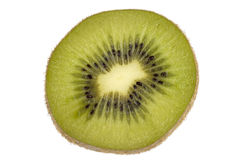 Kiwi with seeds cut through Royalty Free Stock Photos