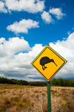 Kiwi sign. Kiwi crossing road sign against cloudy sky at New Zealand royalty free stock images
