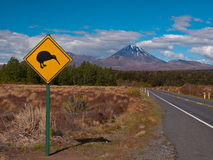Kiwi sign. Kiwi warning sign with volcano in the rear stock photo