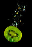 Kiwi sinking in water Royalty Free Stock Photography